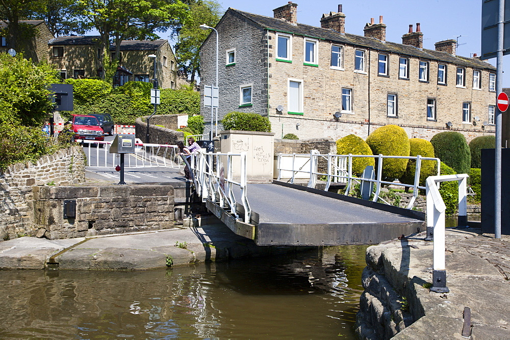 Working a Swing Bridge on the Leeds and Liverpool Canal at Skipton, North Yorkshire, Yorkshire, England, United Kingdom, Europe