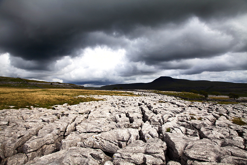 Dark clouds over Ingleborough from Twisleton Scar, Yorkshire Dales, North Yorkshire, Yorkshire, England, United Kingdom, Europe