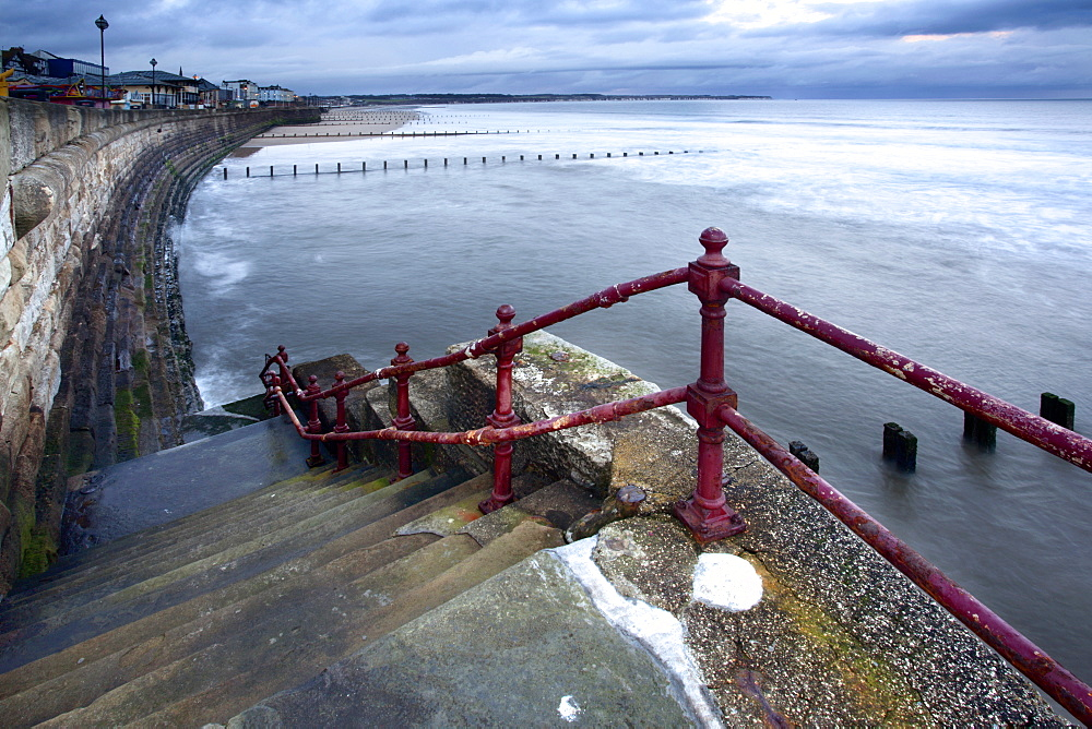 Sea steps and incoming tide at North Sands, Bridlington, East Riding of Yorkshire, England, United Kingdom, Europe