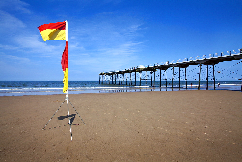 Safe Bathing flag on the beach at Saltburn by the Sea, Redcar and Cleveland, North Yorkshire, Yorkshire, England, United Kingdom, Europe
