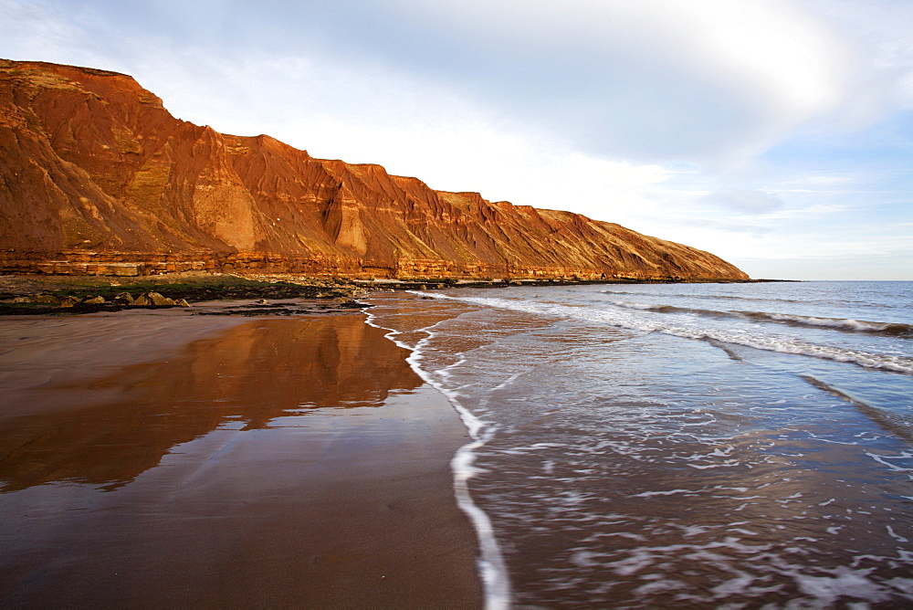 Carr Naze reflected on the wet sands, Filey Brigg, Filey, North Yorkshire, Yorkshire, England, United Kingdom, Europe
