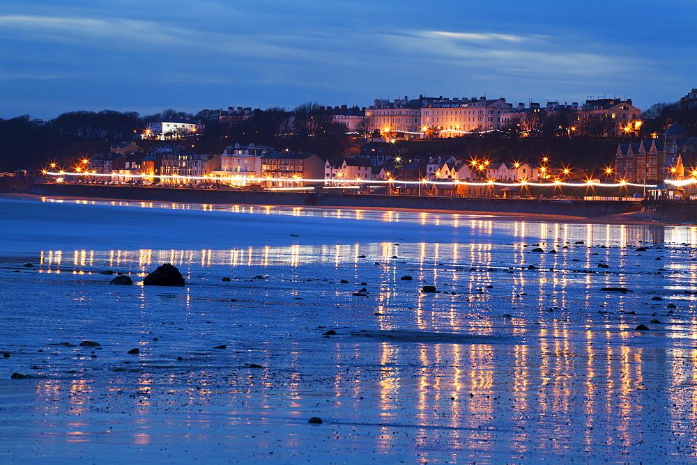 Seafront illuminations reflected on wet sands, Filey, North Yorkshire, England, United Kingdom, Europe