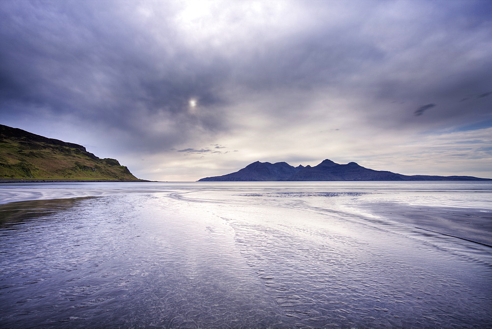 Early evening view towards Rum from the Bay of Laig on the Isle of Eigg, Hebrides, Scotland, United Kingdom, Europe