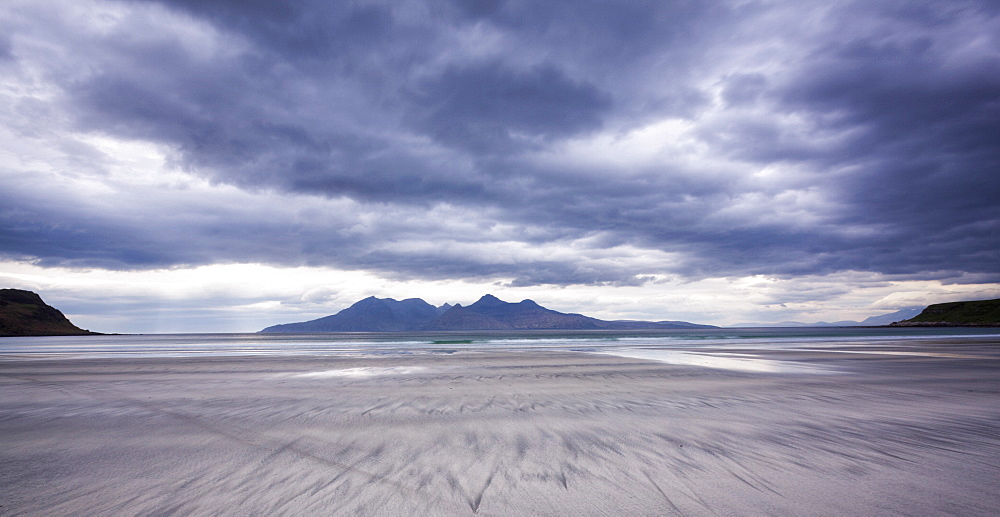 Early evening view towards Rum from the Bay of Laig on Eigg, Inner Hebrides, Scotland, United Kingdom, Europe
