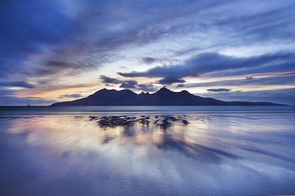 Dusk, looking to towards Rum from the Bay of Laig on Eigg, Inner Hebrides, Scotland, United Kingdom, Europe