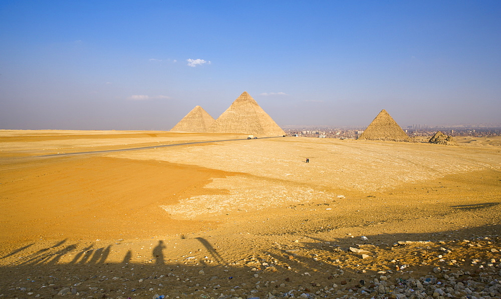 Late shadows of tourists at the viewpoint overlooking the Pyramids of Giza, UNESCO World Heritage Site, with Cairo in the background, Egypt, North Africa, Africa