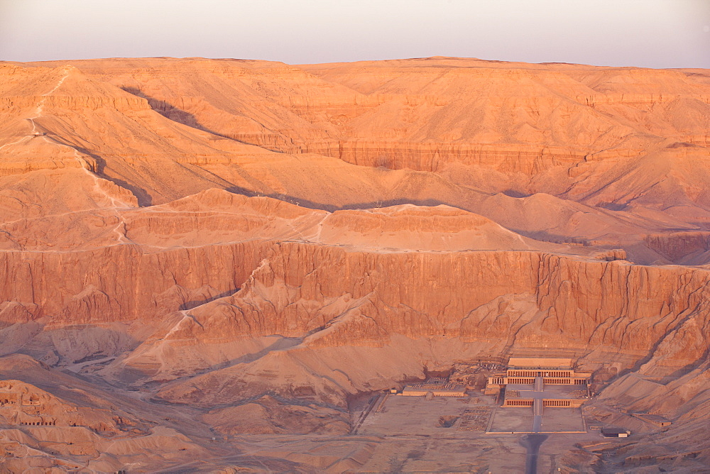 Aerial view from hot air balloon of Hatshepsut's Mortuary Temple at sunrise, Deir el-Bahri, Thebes, UNESCO World Heritage Site, Egypt, North Africa, Africa