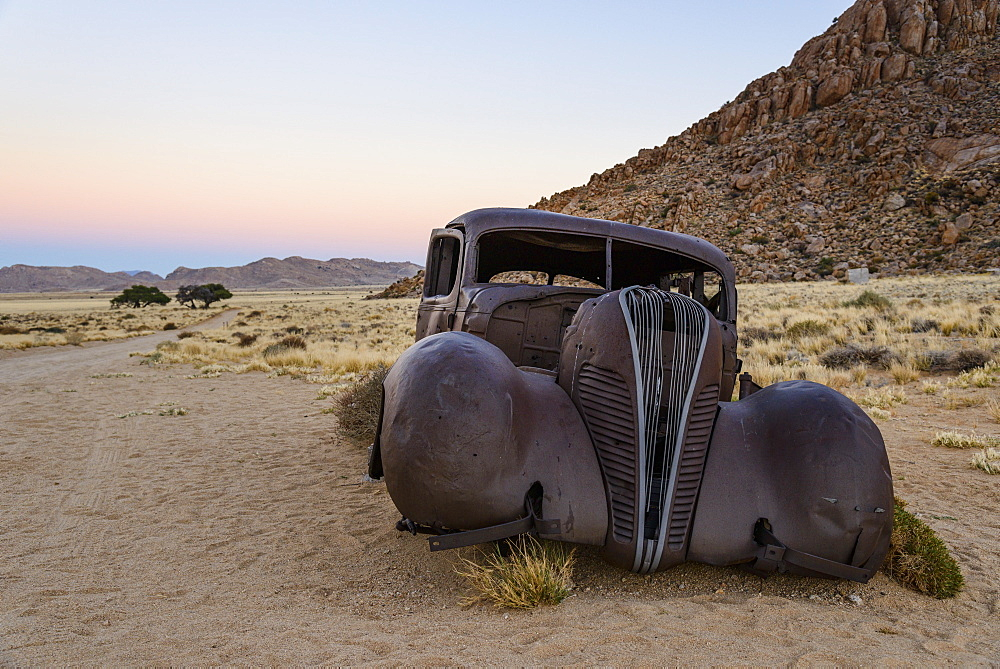 Burnt out remains of an old Hudson car, said to have been used by diamond thieves, in the Gondwana Sperrgebiet Rand Park, Namibia, Africa