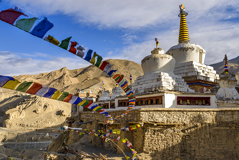 Prayer flags and stupa at the monastery at Lamayuru, Ladakh, Himalayas, India, Asia