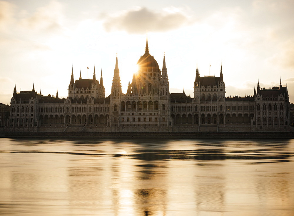 Sunrise behind the Hungarian Parliament Building and Danube River, Budapest, Hungary, Europe
