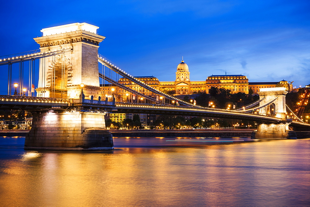 View across Danube River of Chain Bridge and Buda Castle at night, UNESCO World Heritage Site, Budapest, Hungary, Europe