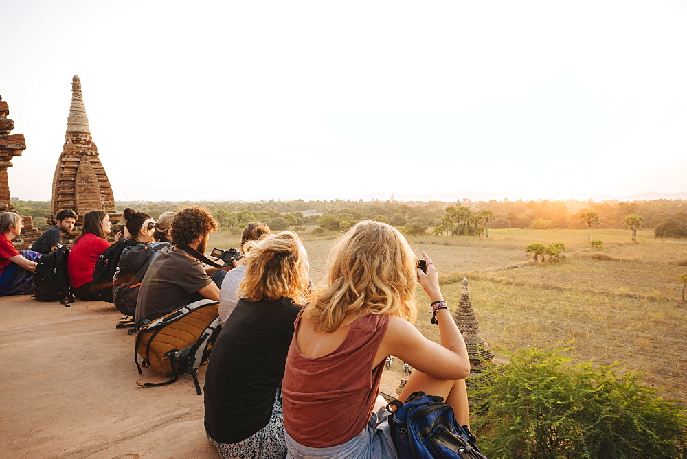 Tourists enjoying the sunset from Temple, Bagan (Pagan), Mandalay Region, Myanmar (Burma), Asia