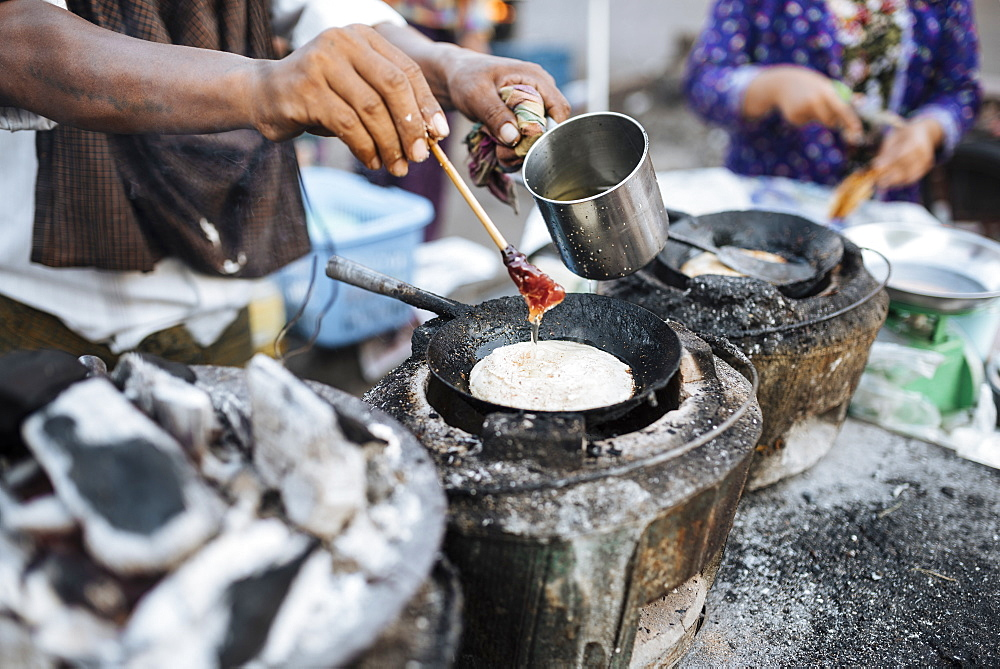 Man making pancakes at street stall, Yangon (Rangoon), Myanmar (Burma), Asia