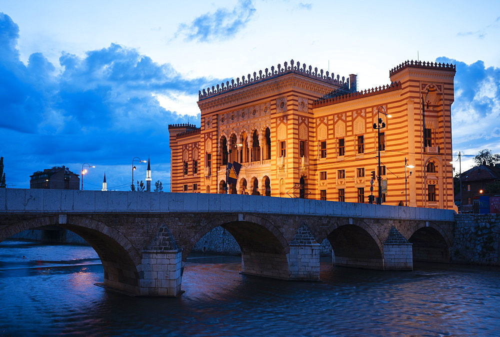 Exterior of Vijecnica (City Hall) at dusk, Old Town, Sarajevo, Bosnia and Hercegovina