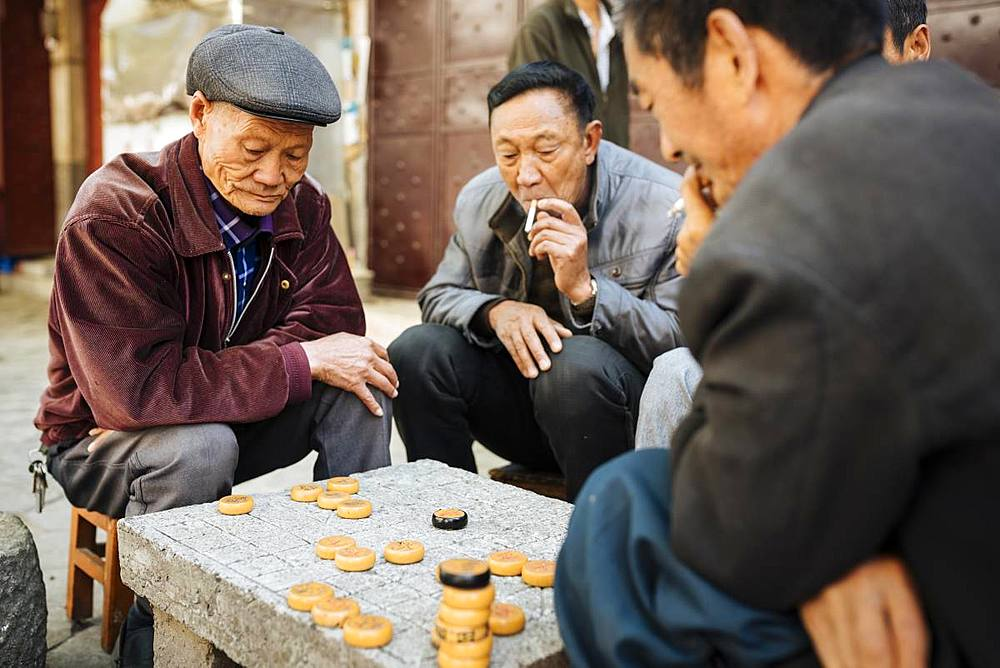 Men playing traditional game of Xiangqi (Chinese Chess), Dali, Yunnan Province, China, Asia