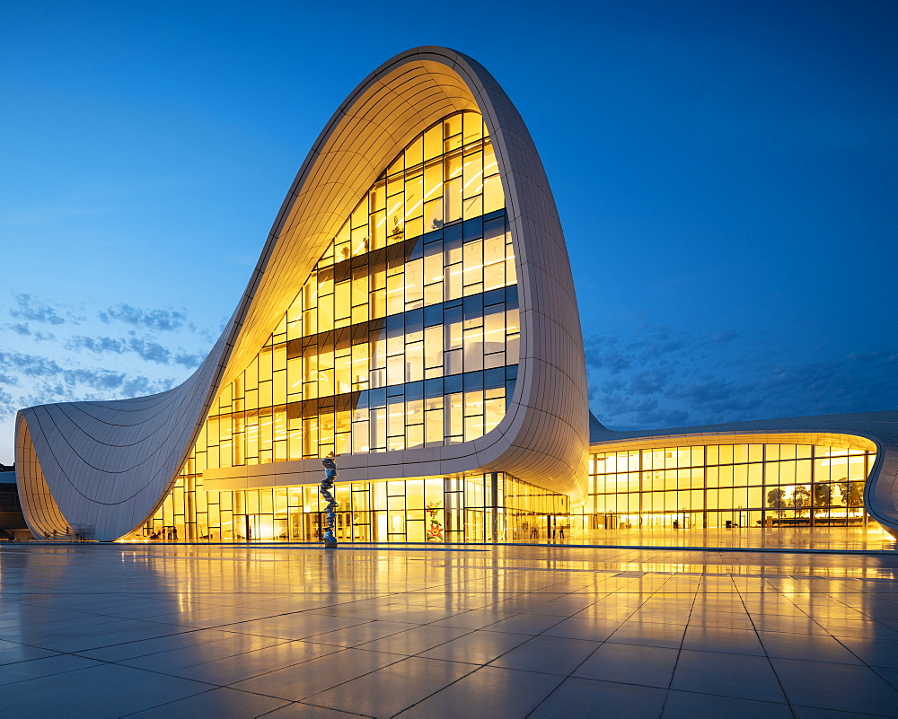 Exterior of Heydar Aliyev Building at night, designed by Zaha Hadid, Baku, Azerbaijan, Central Asia, Asia