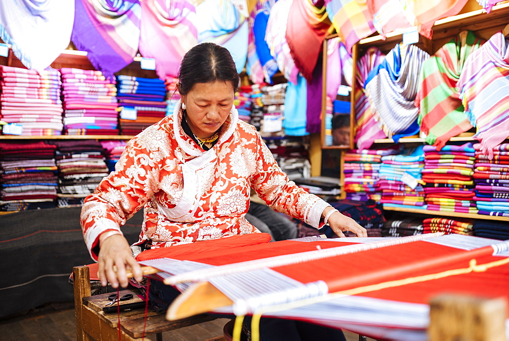 Woman using traditional weaving machine, Lijiang, Yunnan Province, China - 848-1669
