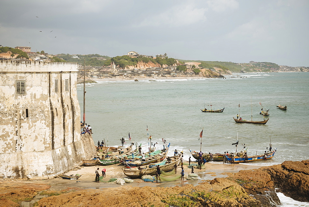 Fishermen preparing boats at Cape Coast Castle, Cape Coast, Ghana, Africa