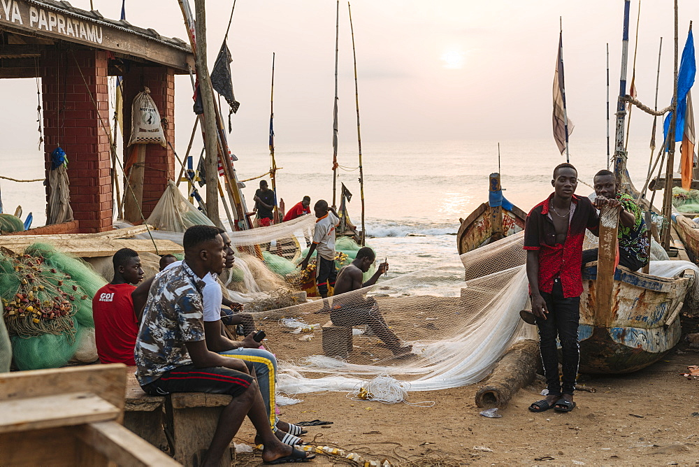 Fishermen fixing nets in Cape Coast, Ghana, Africa