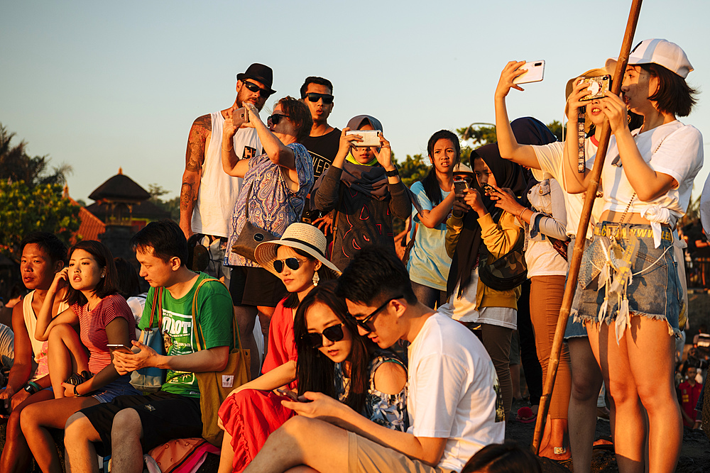 Tourists enjoying sunset at Tanah Lot Temple, Bali, Indonesia, Southeast Asia, Asia
