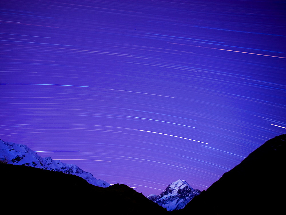 Long exposure of night sky over Aoraki Mount Cook National Park, UNESCO World Heritage Site, South Island, New Zealand, Pacific