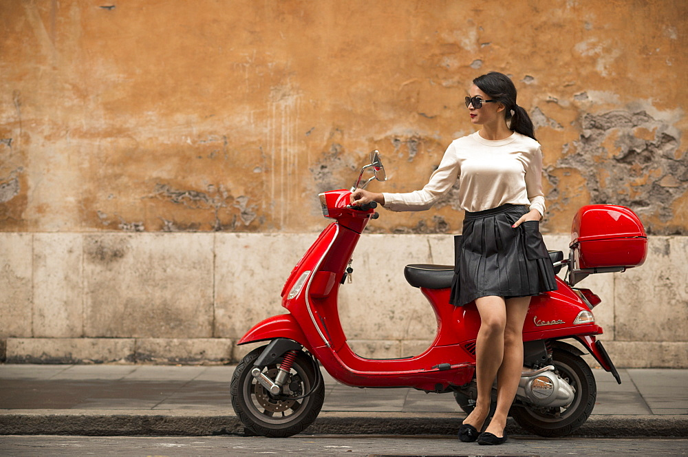 Young woman waiting by Vespa moped, Rome, Lazio, Italy, Europe - 848-628