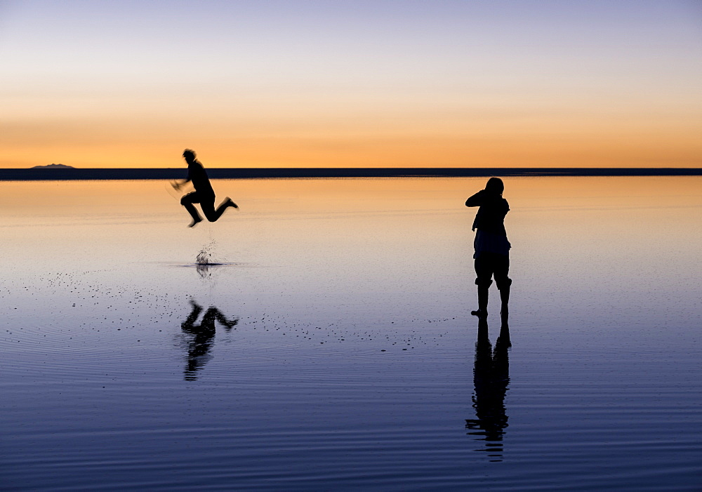 Tourists enjoying the Sunset over the Salar de Uyuni, Southern Altiplano, Bolivia, South America