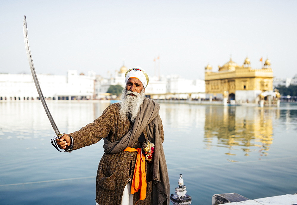 Portrait of Nihang Sikh man, Harmandir Sahib (Golden Temple), Amritsar, Punjab, India, Asia