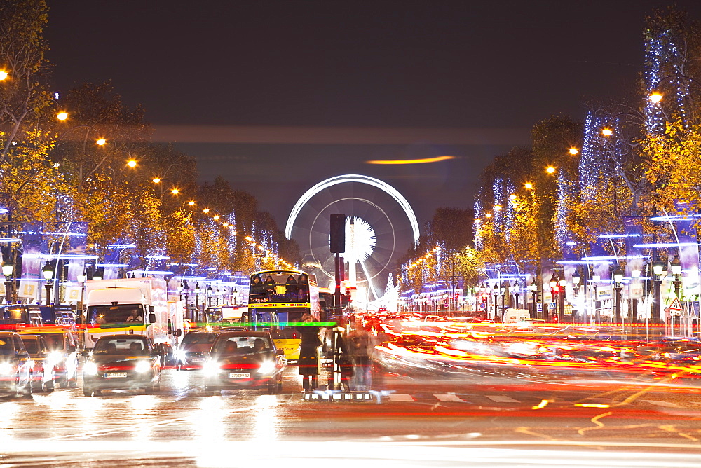 The Champs Elysees lit up by Christmas lights, Paris, France, Europe