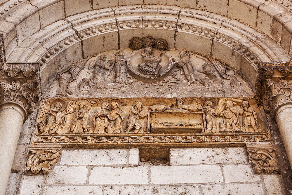 Ancient stonework on an old church door at La Charite-sur-Loire, France, Europe