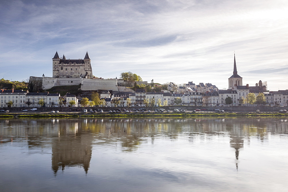 Looking across the River Loire towards the town of Saumur and its castle, Maine-et-Loire, France, Europe