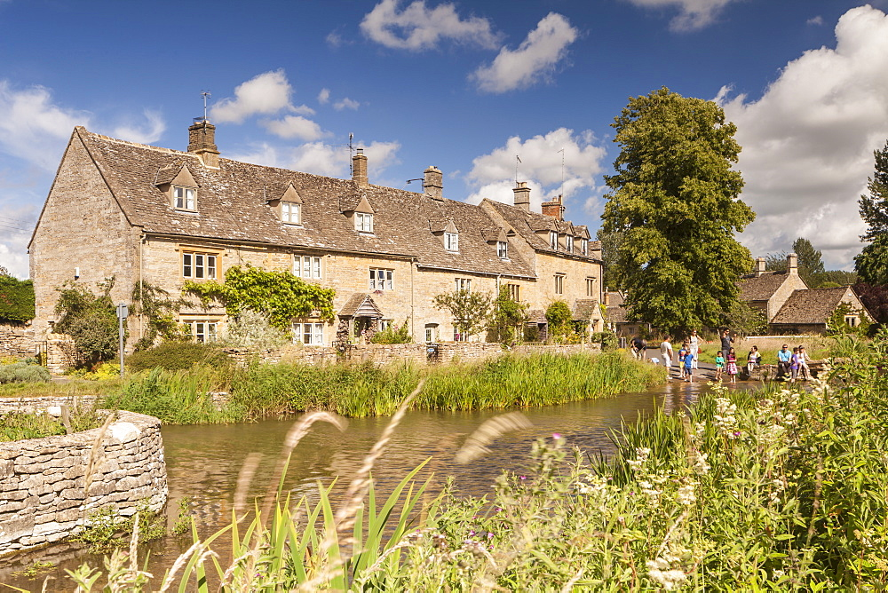 Typical Cotswolds stone houses in Lower Slaughter, Gloucestershire, England, United Kingdom, Europe