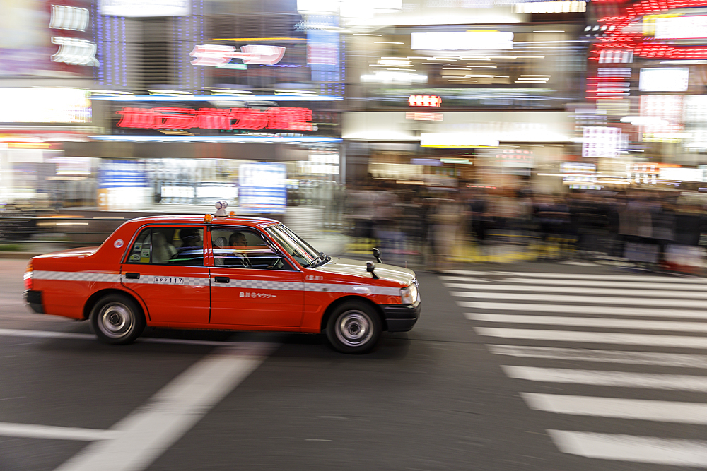 Taxi speeding through the streets of Shinjuku, Tokyo, Asia