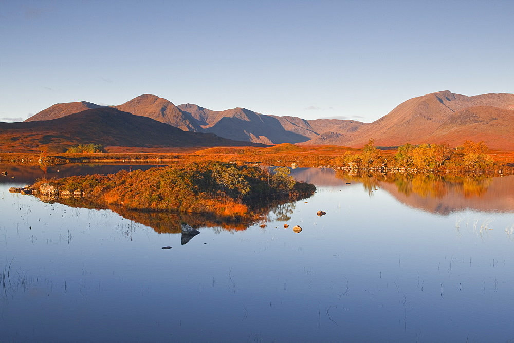 Lochan na h-Achlaise reflecting the surrounding mountains on Rannoch Moor, a Site of Special Scientific Interest, Scotland, United Kingdom, Europe