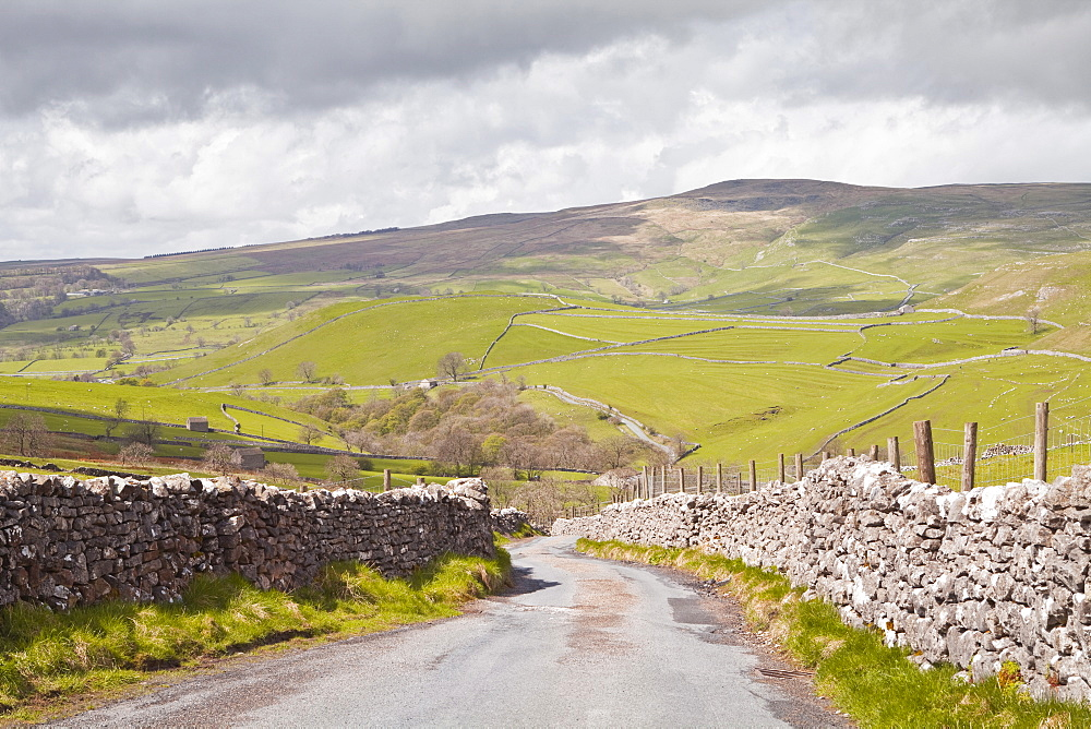 A country road in the Yorkshire Dales near to Malham, Yorkshire, England, United Kingdom, Europe