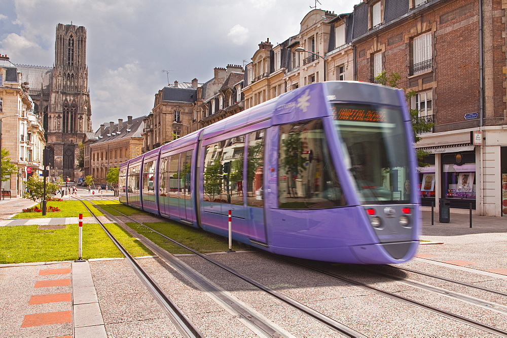 A tram passes in front of Notre Dame de Reims cathedral, Reims, Champagne-Ardenne, France, Europe