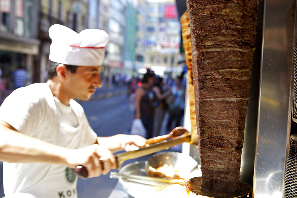 Chef cutting meat for kebab, Istanbul, Turkey, Eurasia