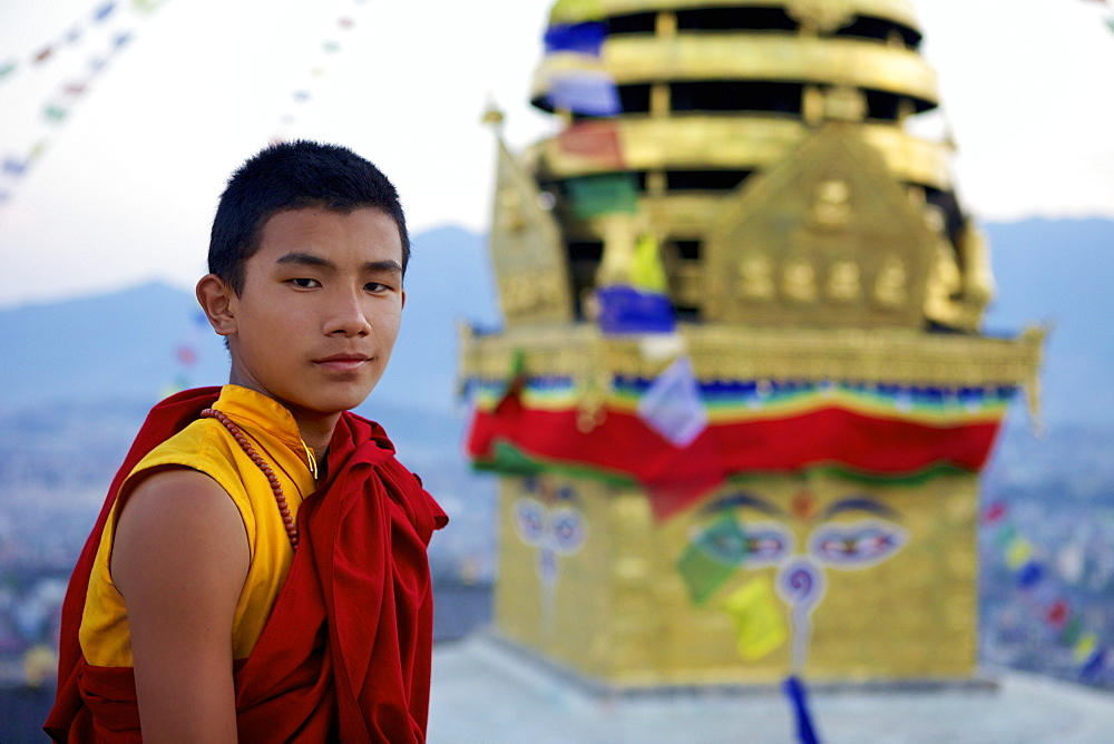 Young Buddhist monk at the Buddhist stupa of Swayambu (Monkey Temple) (Swayambhunath), UNESCO World Heritage Site, Kathmandu, Nepal, Asia
