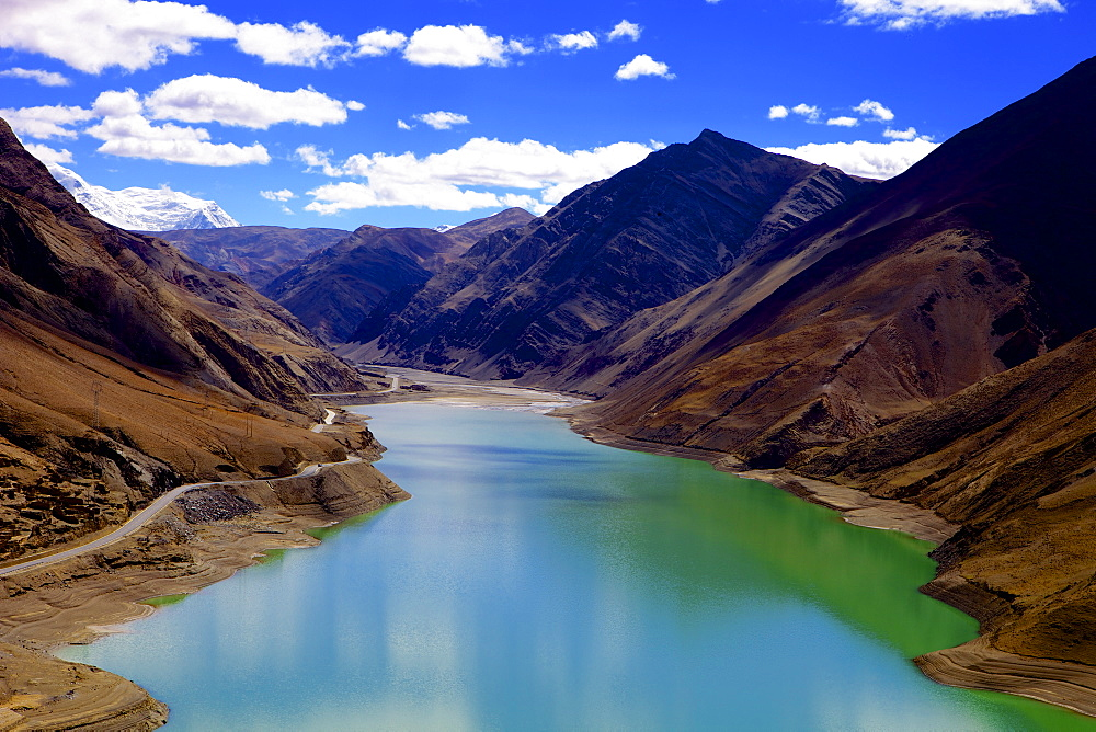 Mountain range and artificial lake (reservoir) near the Karo-La Pass, beside the Friendship Highway, Tibet, China, Asia