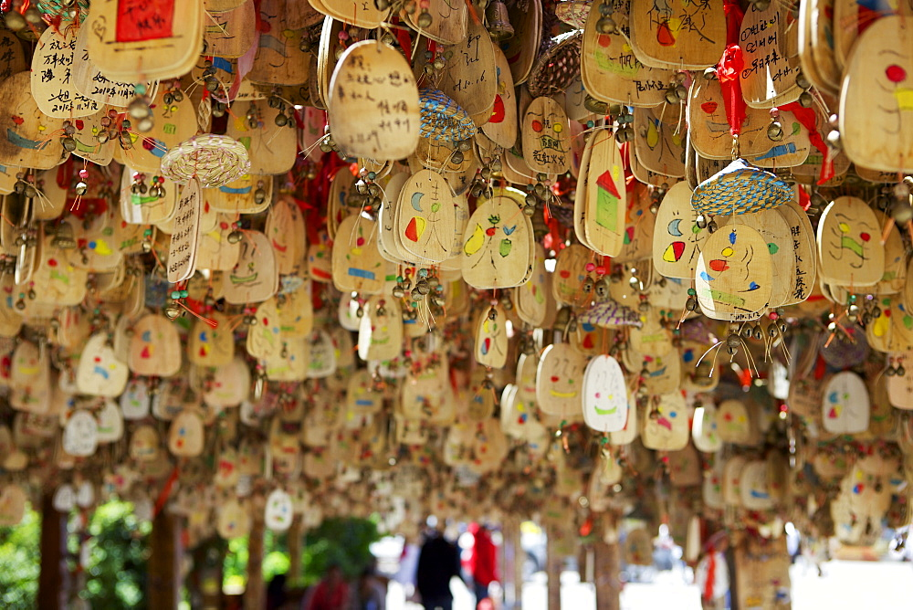 Hanging blessings of Naxi pictograms on wood in the Old Town, Lijiang, UNESCO World Heritage Site, Yunnan Province, China, Asia
