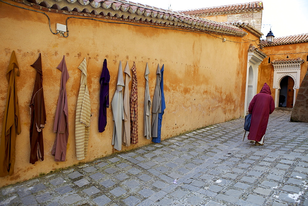 Djellaba garments hanging on a wall, Chefchaouen, Morocco, North Africa, Africa