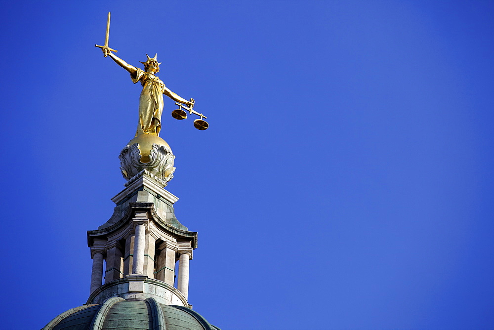 Scales of Justice above the Old Bailey Law Courts (Central Criminal Court) on former site of Newgate Prison, London, England, United Kingdom, Europe