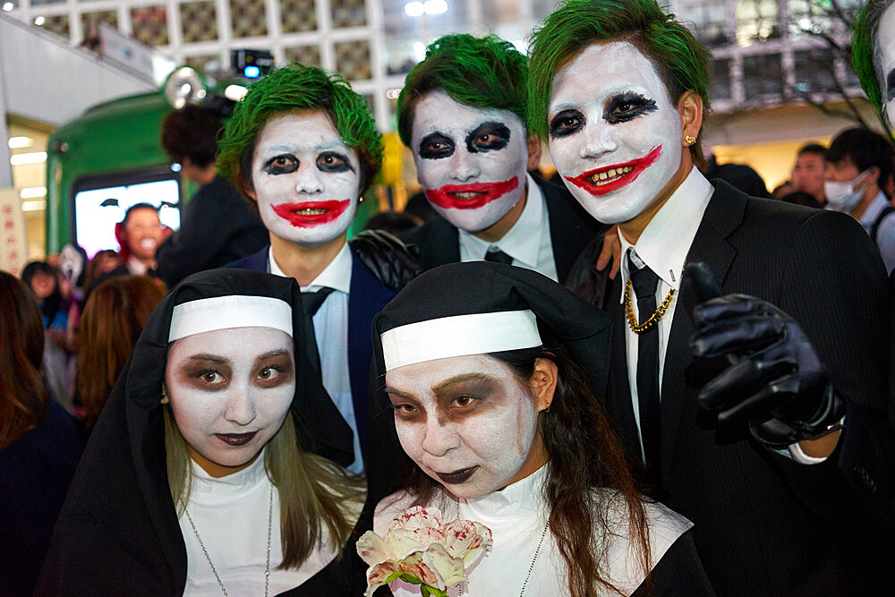 Nuns and jokers at the Halloween celebrations in Shibuya, Tokyo
