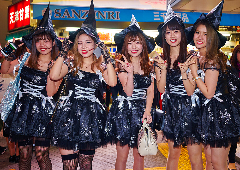 A group of young Japanese girls dressed as witches at the Halloween celebrations in Shibuya, Tokyo