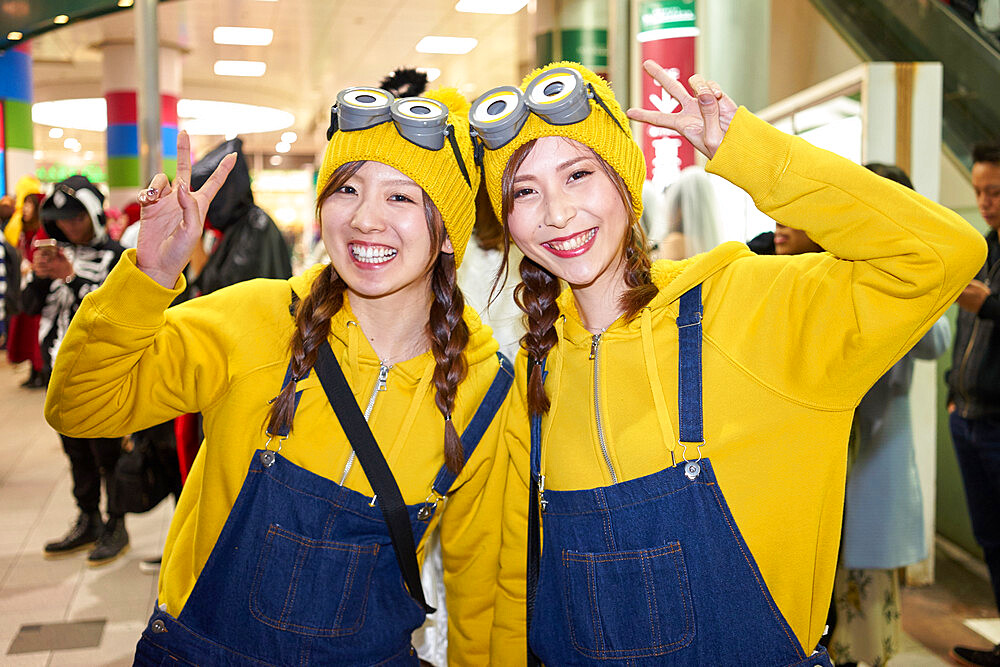 Young Japanese girls dressed as Minions at the Halloween celebrations in Shibuya, Tokyo - 851-645