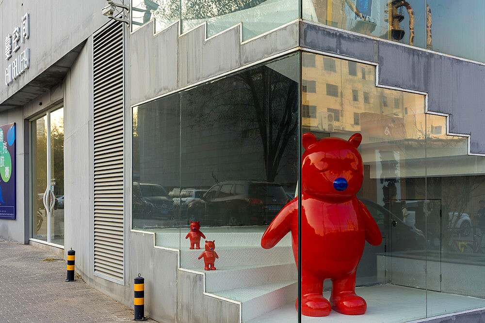 Red bear sculpture at the 798 Art Zone (Dashanzi Art District) in Beijing, China, Asia