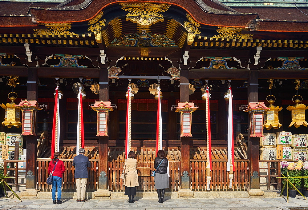 People praying at Kitano Tenmangu Shrine, Kyoto, Japan, Asia