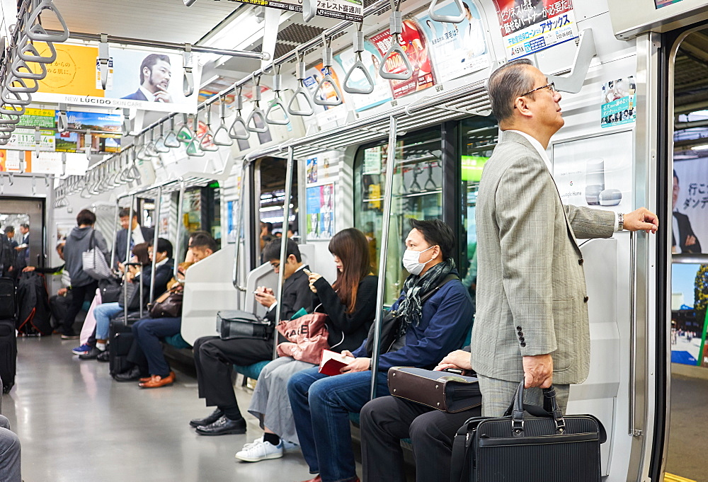 Passengers on a Tokyo subway train, Tokyo, Japan, Asia
