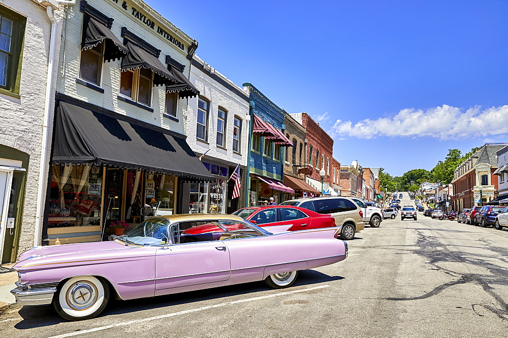 A Pink 60???s Cadillac in the historic old town of Weston, MO, USA. - 851-932