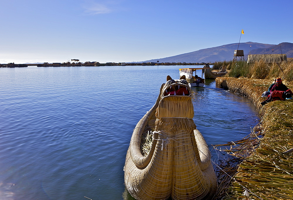 Floating islands of the Uros people, traditional reed boats and reed houses, Lake Titicaca, peru, peruvian, south america, south american, latin america, latin american South America